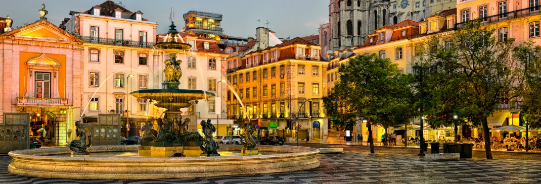 The fountain in Rossio square, Portugal spraying water