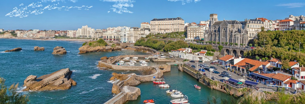 Biarritz coast with boats and and waterfront buildings