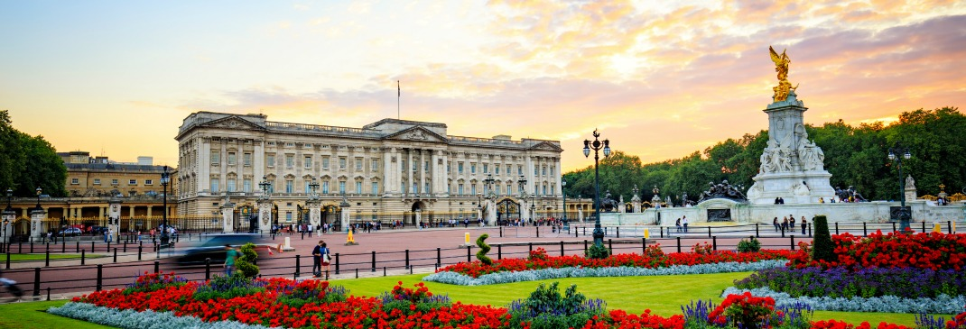 The Royal residence of Buckingham Palace in London shown around sunset