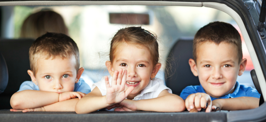 Children in back of hire car