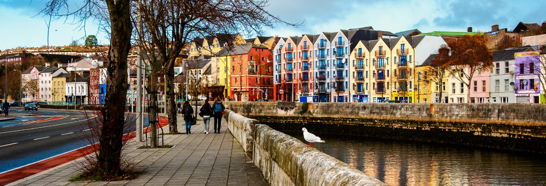 The shops, bars and restaurants on the bank of the River Lee in Cork's city center.